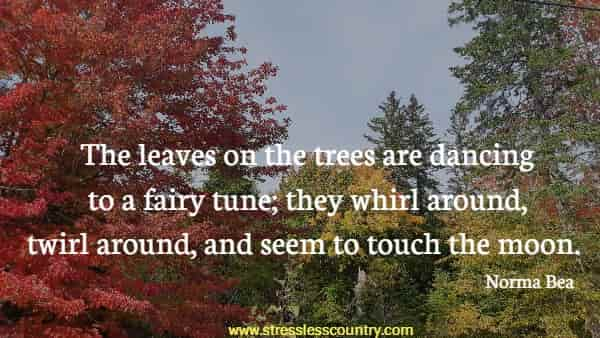 The leaves on the trees are dancing to a fairy tune; they whirl around, twirl around, and seem to touch the moon.